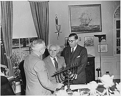 Truman in the Oval Office, receiving a Hanukkah Menorah from the prime minister of Israel, David Ben-Gurion (center). To the right is Abba Eban, ambassador of Israel to the United States