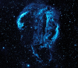 This GALEX image of the Cygnus Loop nebula could not have been taken from the surface of the Earth because the ozone layer blocks the ultra-violet radiation emitted by the nebula.
