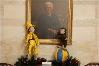 The White House 2003 Christmas decoration using Curious George as the theme with the Barbara Bush portrait.