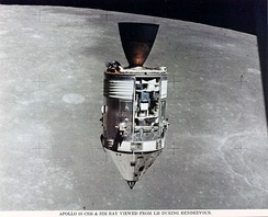 A spacecraft seen with the Moon in background