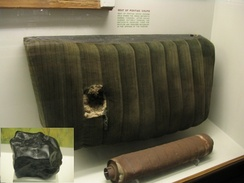 Photo of the car seat and muffler hit by the Benld meteorite with the meteorite inset.