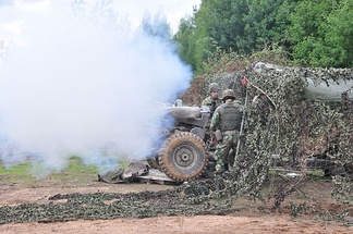 Firing of a L118 light gun 105 mm howitzer of the Portuguese Army.