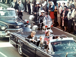 President John F. Kennedy riding in a convertible car outside Dallas, along with his wife, Jacqueline, and others inside, minutes before he was killed.