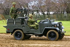 A vehicle with a Sumitomo M2 heavy machine gun mounted at the rear