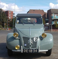 1957 Citroën 2CV with selective yellow headlamps and auxiliary lamp