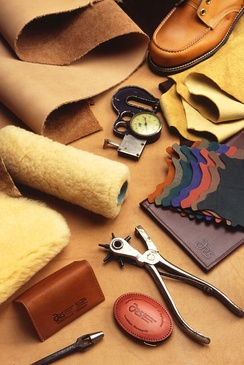 A variety of leather products and leather-working tools