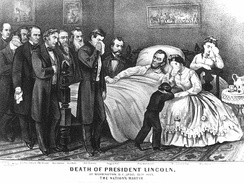 Abraham Lincoln lay on his deathbed at the Petersen House in Washington, surrounded by family, friends and government officials.