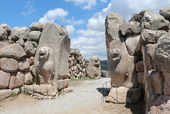 The Lion Gate in Hattusa, capital of the Hittite Empire. The city's history dates back to the 6th millennium BC.[43]