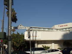 Merv Griffin Way with The Beverly Hilton in the background, in Beverly Hills, California.
