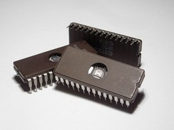 Erasable Programmable Read-Only Memory (EPROM) integrated circuits.  These packages have a transparent window that shows the die inside. The window is used to erase the memory by exposing the chip to ultraviolet light.