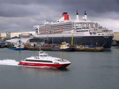 Queen Mary 2 at the new Ocean Terminal, with Isle of Wight passenger ferry Red Jet 3
