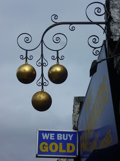 A London shop displays the traditional pawnbroker's sign.