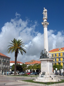 Statue of Setúbal poet Manuel Maria Barbosa du Bocage in a city square.