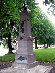 A French obelisk memorial, decorated with the croix de guerre, palm of peace and a Gallic rooster