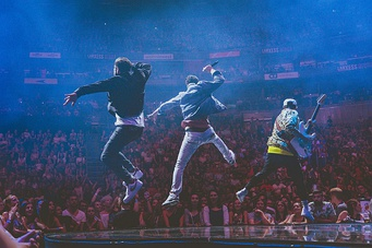 The Shadowboxers leap during their performance on Justin Timberlake's MOTW Tour