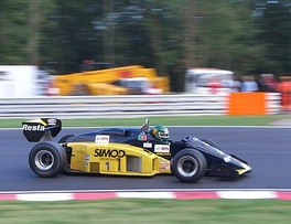 1985 vintage Minardi M185 driven by Roderigo Gallego at a Thoroughbred Grand Prix event at Brands Hatch in September 2005