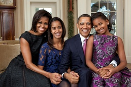 Official portrait by Pete Souza of the Obama family in the Oval Office, December 11, 2011.