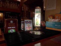 Assorted keg beer taps (Dark Mild, Taddy Lager, Pure Brew Organic Lager)