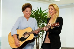 Brazil's president Dilma Rousseff receiving a guitar for Shakira's charity auction (2011)
