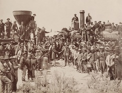Dodge at right center shaking hands with Samuel S. Montague at the Golden Spike Ceremony. Photograph by Andrew J. Russell