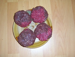 Approximately 0.45 kg (1 lb) of ground elk meat formed into patties; they have relatively low fat content