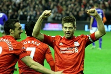 Gerrard celebrates after scoring a hat-trick in the Merseyside derby in 2012