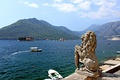 Stone lion and the Bay of Kotor. Perast, Montenegro.