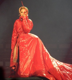 "Gaga during the performance of ""Bloody Mary"". The red costume was noted for ""bringing back the avant garde looks"" that have been characteristic of her.[25]"