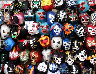 A selection of wrestling masks sold at stores.