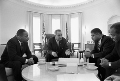President Lyndon B. Johnson (centre) with Rev. Martin Luther King, Jr. and other Civil Rights leaders in 1964.