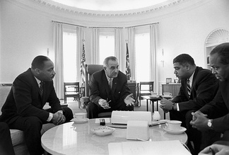 President Lyndon B. Johnson (center) meets with civil rights leaders Martin Luther King Jr., Whitney Young, and James Farmer, January 1964