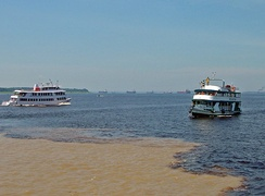 Meeting of Waters; the confluence of Rio Negro (black) and Amazon (sandy) near Manaus, Brazil