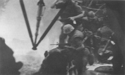 Marines of 3rd Platoon, Company G board Jolly Green 11 to evacuate the East Beach