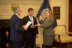 Michelle Bowman, accompanied by her husband Wes Bowman, is sworn in by Jerome Powell for her second term as a member of the Board of Governors of the Federal Reserve System