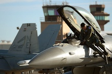 U.S. Air Force 2nd Lt. Lazir Ablaza, a fighter pilot with the 157th Fighter Squadron at McEntire Joint National Guard Base, SC, prepares to launch an F-16 Fighting Falcon for a training mission from Naval Air Station Fallon, Nov. 13, 2014.