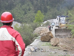 Persistent rain, as well as rock slides and a layer of mud coating on the main roads, such as the one above, hindered rescue officials' efforts to enter the target region.