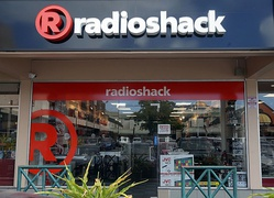 The exterior of a Unicomer-owned RadioShack store in Trinidad (2017). Notice the slightly different logo that Unicomer stores used.