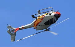 A Eurocopter EC120 helicopter demonstrates its agility with a barrel roll