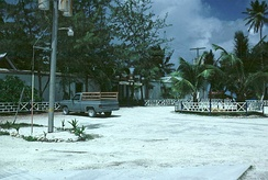 This 1982 photo shows an unpaved road made of crushed coral common throughout the island and the officers' dining area at the Diego Garcia Naval Support Facility.