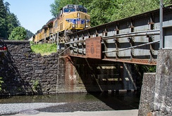 "Union Pacific #5391, approaching bridge at Multnomah Falls Oregon, shows the white-outlined blue ""wings"" on the nose"