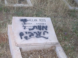 "Vandalized grave. The graffiti says ""death to the Arabs"" by an unknown."