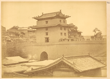 The West Gate (西关; Xīguān) of the old city wall in 1875. It has been demolished, although its busy neighborhood still bears its name.