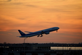 An All Nippon Airways Boeing 777-300 taking off from New York JFK Airport