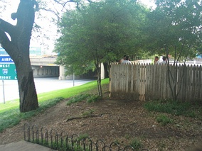 The wooden fence on the grassy knoll, where many conspiracy theorists believe another gunman stood.