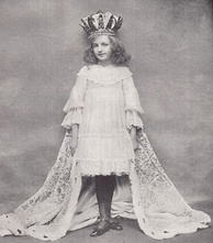 Maidie Andrews as Alice in Alice Through the Looking-Glass at the Comedy Theatre during the Christmas period 1903–04. Pictured in The Tatler (January 1904)