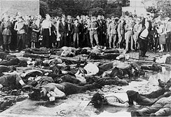 Civilians looking at the massacre of 69 Jews in the Lietukis garage of Kaunas on June 25 or 27, 1941.