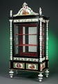 Ebonized vitrine featuring hand painted Meissen porcelain mounts, Circa 1870.