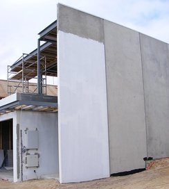 A house being built with prefabricated concrete panels.