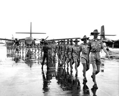 Personnel and aircraft of RAAF Transport Flight Vietnam arrive in South Vietnam in August 1964