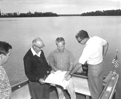 Roy O. Disney inspecting design plans on-site in Florida.